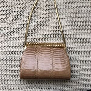 Clutch snake leather used very gently
